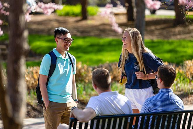 students on Creighton University campus talking