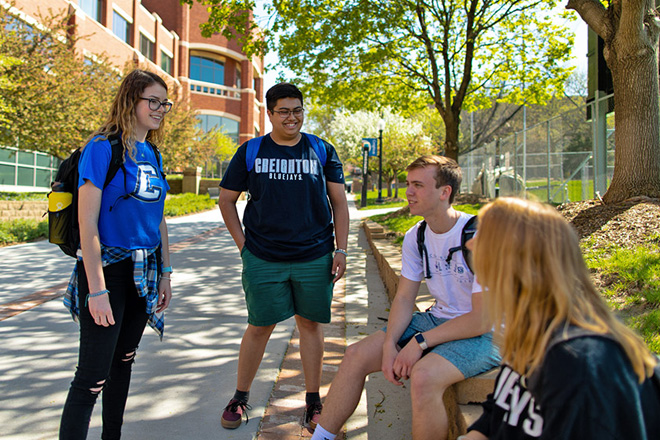 Creighton University students talking to one another