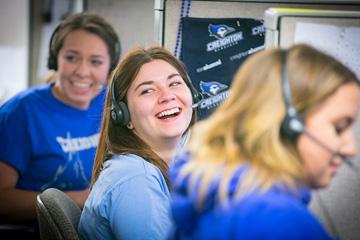 three female Creighton University students working phonathon and laughing