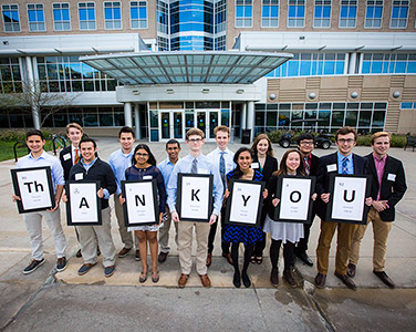 Creighton students holding signs that spell out thank you