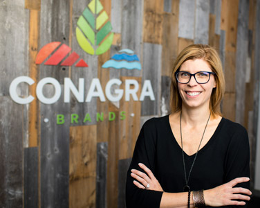 woman standing before Conagra sign