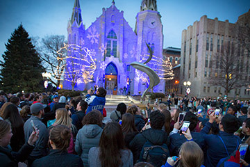 St. John's Cathedral lit up in blue lights on Creighton campus