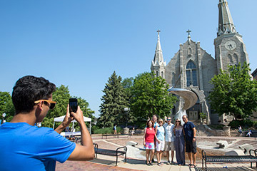 people posing before St. John's on Creighton campus