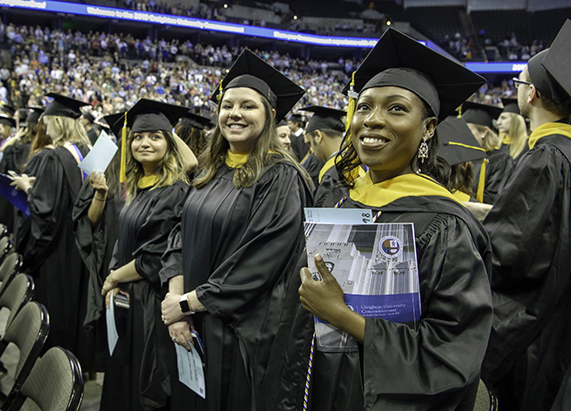 Graduates look on during commencement 2019