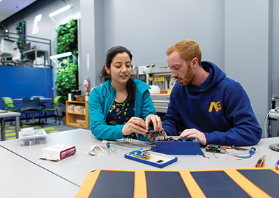 Two students work on tech in the Radlab.