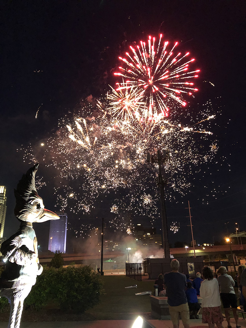 Reunion Weekend fireworks show with Billy Bluejay statue