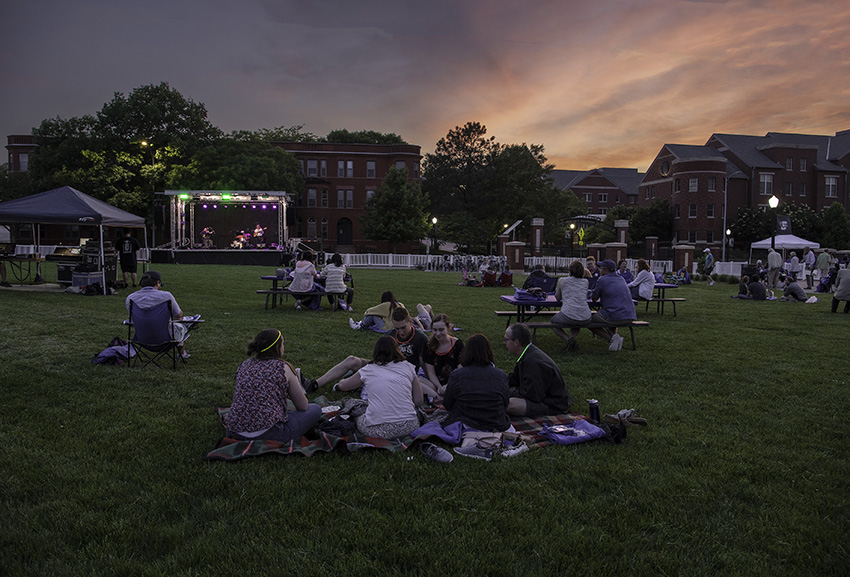 People sit on the Morrison lawn during the Reunion Weekend concert