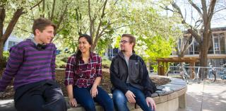 Three students talking on Creighton's campus.
