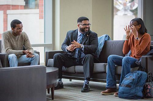 Dr. Whitt talks with student in Harper Center