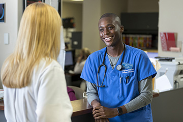 A nurse and physician have a conversation.